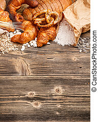 Baked goods on old wooden background
