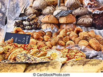 Baked goods at a bakery or market stall. Various pastries...