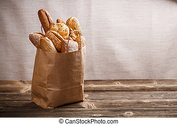 Baked goods - Assortment of baked goods packaged in a paper...