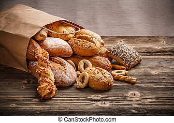 Baked goods - Assortment of baked goods on old wooden table