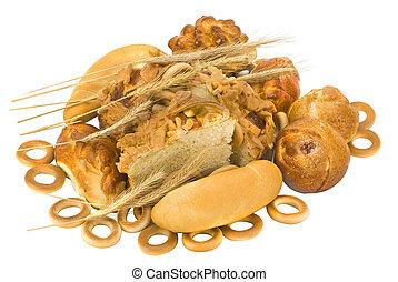 baked goods - many golden baked goods on white