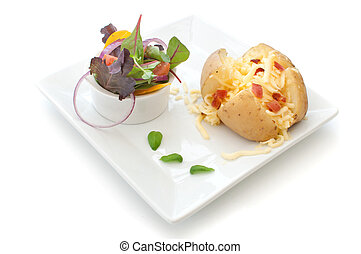 Baked Jacket potato - Grated cheese and bacon pieces with...