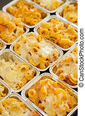 Baked macaroni cheese in row