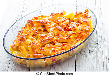 Baked macaroni cheese with tomatoes and sausage