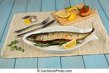 Baked mackerel with lemon on blue table