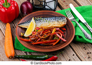 baked mackerel with vegetables on wooden table