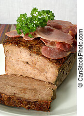 baked meat loaf with organic parsley on a plate