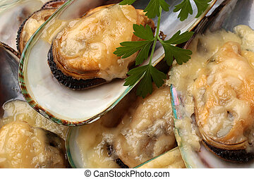 Baked mussels with cheese, for backgrounds or textures