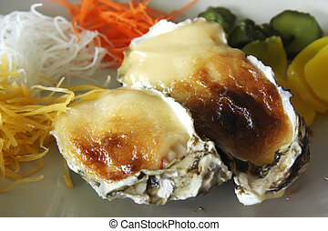 Baked oysters with cheese sauce au gratin