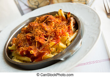 Baked pasta with sausage and tomatoes