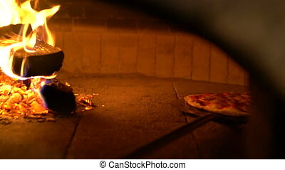 Baked pizza by in traditional vintage oven - Baked pizza by...