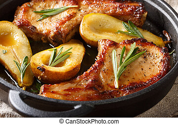 Baked pork chops with pears, rosemary and honey in a pan close-up. horizontal