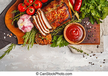Baked pork with thyme, rosemary, garlic and tomato sauce on wooden board, white background, copy space.