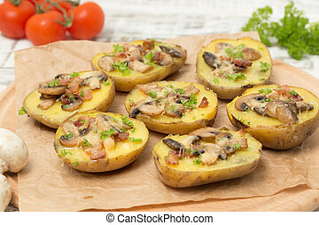 baked potato with mushrooms and bacon with cheese.