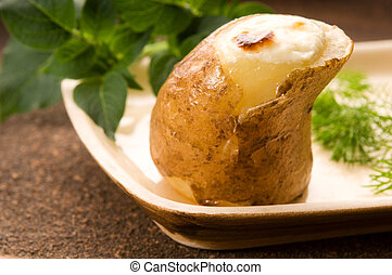 Baked potato with sour cream and fresh dill