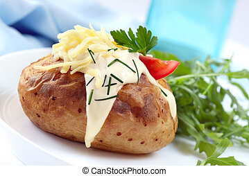 Baked Potato with Sour Cream Grated Cheese Chives and Salad