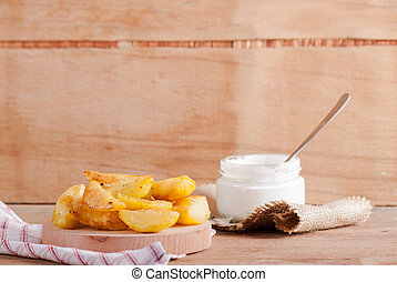 Baked potatoes with sour cream sauce