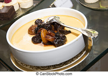 Baked pudding with apricot Arabic sweets background