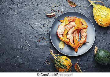 Baked pumpkin in bacon.