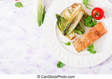 Baked salmon with Italian herbs and garnished with chicory....