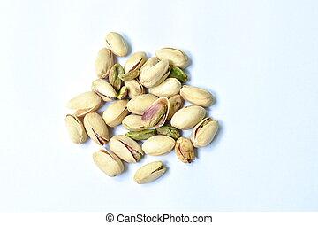 baked salty pistachio nut arranging on white background