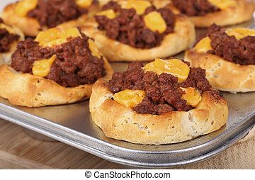Baked Sloppy Joe Biscuits - Baked sloppy joe biscuits in a...
