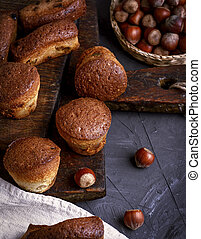baked small cupcakes on a brown wooden board