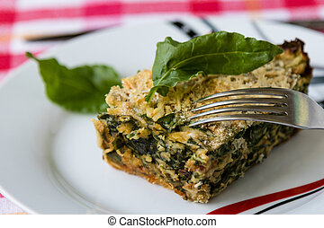spinach souffle - baked spinach souffle on white table with...