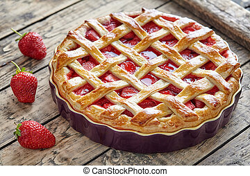 Baked strawberry pie cake sweet pastry on rustic table -...