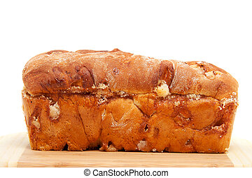 baked sugar bread in closeup on cutting board