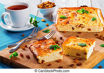 Baked Sweet Cottage Cheese casserole with raisins decorated mint