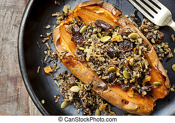 Baked Sweet Potato Stuffed With Wild Rice Seeds and Cranberries