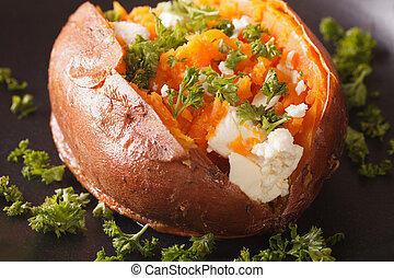 baked sweet potatoes stuffed with feta and parsley closeup...