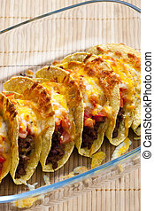 baked tacos with tomatoes and minced meat
