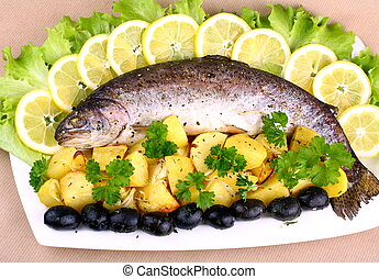 Baked trout with potatoes, black olives, lemon and salad