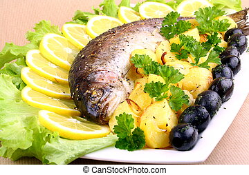 Baked trout with potatoes, black olives, salad and lemon