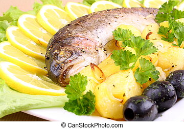 Baked trout with potatoes, olives, salad and lemon