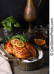Baked whole chicken in a tray