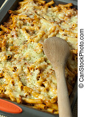 Baked Ziti - Baked ziti in a pan with a wooden spoon, ready ...