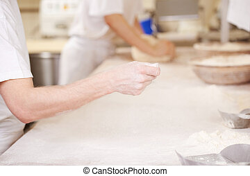 Baker at work - Baker during manual labor in his laboratory