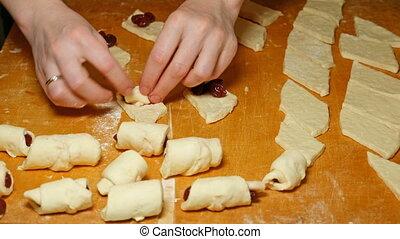 Baker cooks diy croissants in hand made bakery