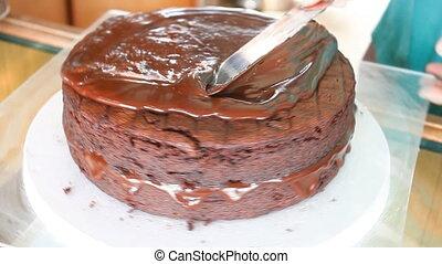 Baker decorated chiffon chocolate cake with chocolate...