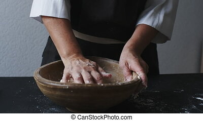 Baker hands kneading dough