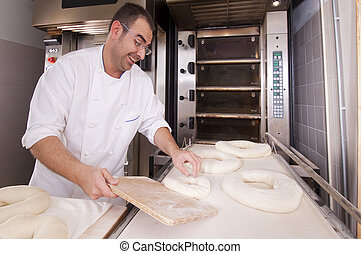 Baker makes the bread kneaded in the oven