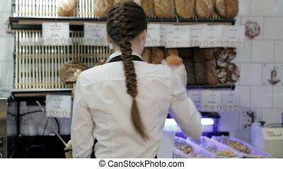 Baker offering a loaf