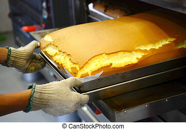 taiwanese traditional sponge cake - Baker taking out...