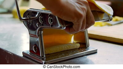 Baker using pasta cutter in bakery shop 4k - Close-up of ...
