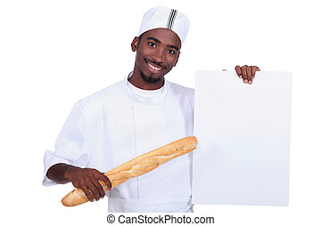Baker with a baguette and a board left blank for your message