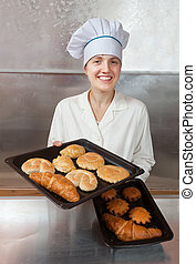 Baker with fresh bake   - Baker with fresh bake on trays