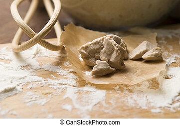 Baker's yeast on wooden board